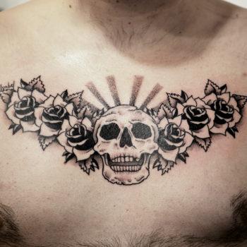 chest tattoo cannes skull roses crane fleurs flowers blackwork